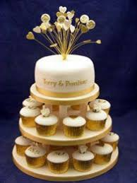 50th anniversary cake ideas golden 50th anniversary cupcake tower with rosette top cake all