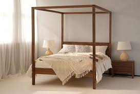 Wrought Iron And Wood Nightstands French Style Bedroom With Wrought Iron Chandelier And Canopy Bed