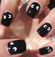 orange and white ghost face halloween nail art beneath nail art