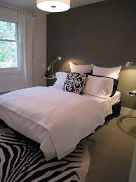 gray accent wall bedroom connected by white bed and round bedside