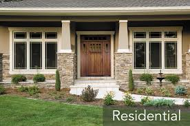 doors with glass windows door green grass with stone wall plus glass window and wooden
