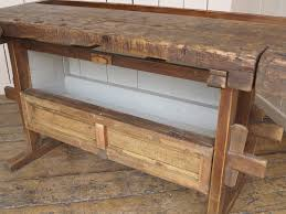 antique woodworking bench with two vices and storage box