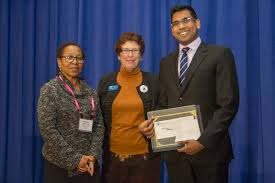 Michael Muthukrishna wins the      CGS ProQuest Distinguished     From left  Marlene Coles  ProQuest  Suzanne Ortega  CGS  and Michael Muthukrishna