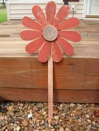 large wooden sunflower lawn ornament outside lawn