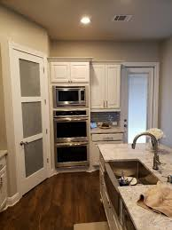 what is the cost of new cabinets how much should will it cost to modify cabinets to fit new