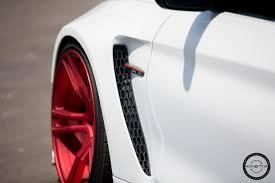 bmw m4 widebody alpine white widebody bmw m4 looks great on red wheels my car portal