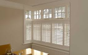 cafe style shutters in a square bay window surrey blinds u0026 shutters