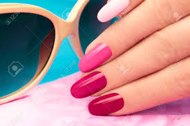 pink manicure covered different in tone nail polish on oval shaped