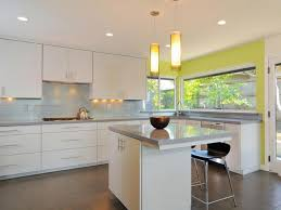 yellow wall color ideas with white kitchen cabinet and tube shaped
