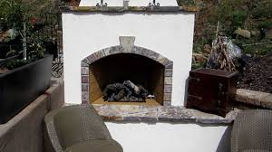 eldorado hills outdoor fireplace built into a hillside pool side
