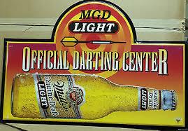 miller genuine draft light huge miller genuine draft light mgd dart metal tin beer sign man
