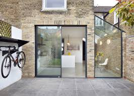 rise design studio adds glass extension to london house glass