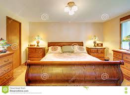 cozy bedroom with light brown wood furniture set stock photo