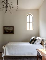 bedroom divan with headboard and white slipcover also rustic