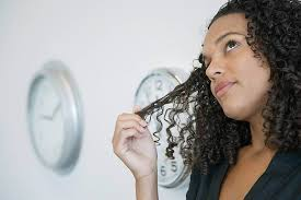 when a guys tuck hair ears means what does it mean when a girl plays with her hair while talking to