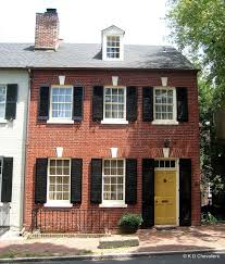 old town alexandria brick house with yellow door yellow doors