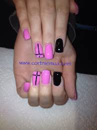 pink and black acrylic nails with cross cortnie grno nails
