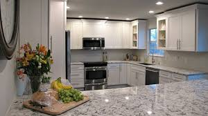 granite ideas for white kitchen cabinets white granite countertops pictures cost pros and cons