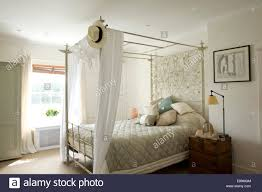 Cotton Drapes White Cotton Drapes On Four Poster Bed With Ornate Metalwork Panel