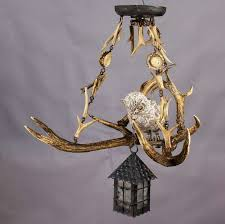 Metal Antler Chandelier Antique Black Forest Antler Chandelier With Owl Statue At 1stdibs