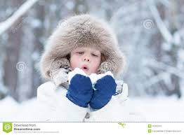 cute child playing with snow in a winter park stock photo image