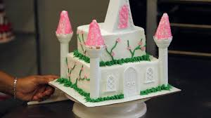 castle cakes how to decorate a princess castle cake with flowers howcast