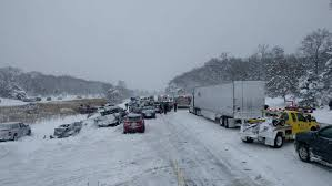 huge multi vehicle pileup in michigan sends cars into river and