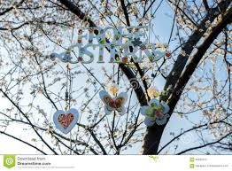 painted letters happy easter in german on flowering tree decor
