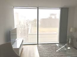 sunscreen roller blinds for floor to ceiling windows in apartment