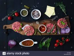 Cooking Board by Ingredients For Cooking Burgers Raw Ground Beef Meat Cutlets On