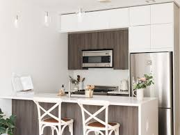 kitchen wall cabinets how high when should cabinetry go to the ceiling