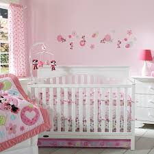 white wooden cradles with pink minnie mouse bedding set and