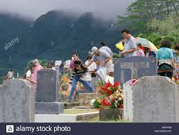 tombstones for families gathered around tombstones for ching ming an annual