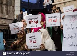 political organizing people holding posters during protest in egypt compatriots
