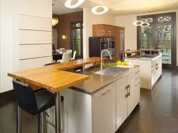 tiered kitchen island with breakfast bar and banquette kitchens