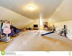 large long attic game room with tv clothing rack and sport