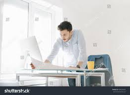 young man modern office design sketching stock photo 404037643