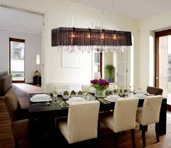 dining room dramatic dining room light fixture off center