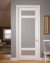Glass Barn Doors Interior by Simple Vintage Styled Interior Doors With Frosted Glass And Using