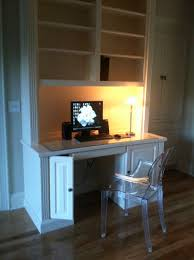 built in computer desk and bookshelf with louis ghost chair