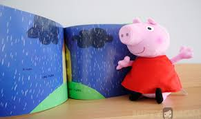 enjoying story u0027peppa pig muddy puddles u0027 book