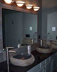 half round vanity lights above the rectangle mirror combined with