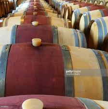 close up of wine barrels in cellar stock photo getty images