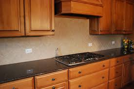 cherry kitchen cabinet design with kitchen hood and cream tin