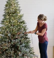 how to put lights on a christmas tree video tutorial for adding lights to a christmas tree sincerely sara d