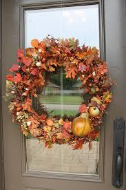 pumpkin door decoration 43 autumn door decorations to make fall wreath in orange colors 9