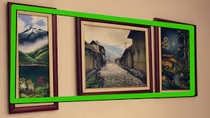 hang paintings without damaging walls 3 ways to hang a painting wikihow