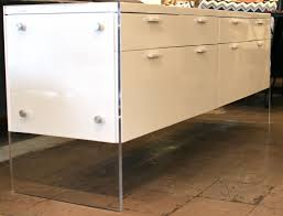 white lacquer sideboard w lucite base acrylic base plastic