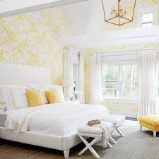 yellow and white bedroom white and yellow bedroom with vaulted ceiling and white x stools
