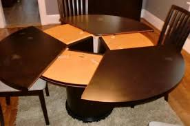 expandable round dining table expanding round dining table ispcenter expanding round dining